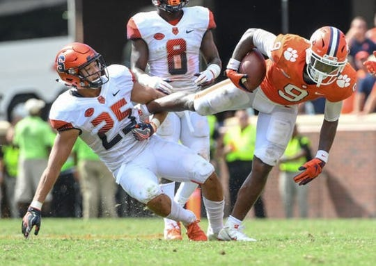 Clemson's Travis Etienne eyes running room in Clemson's victory against Syracuse in 2018.