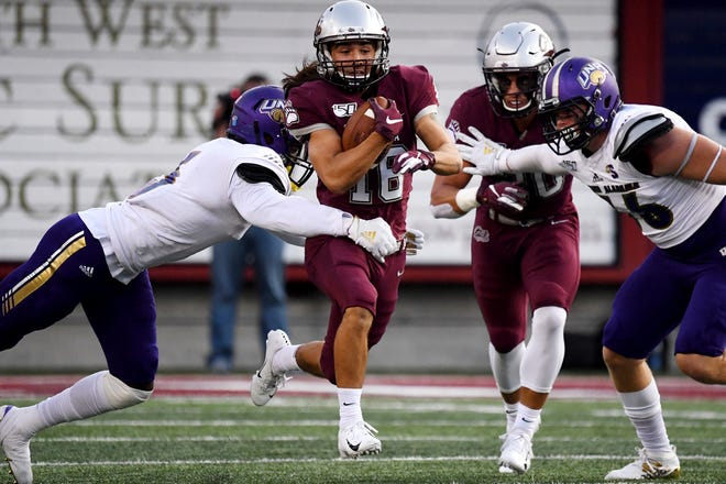 Montana's Jerry Louie-McGee breaks a tackle in the first quarter against North Alabama in an NCAA college football game Saturday, Sept. 7, 2019, in Missoula, Mont. (Tommy Martino/The Missoulian via AP)