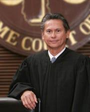 Associate Justice Philip Carbullido.