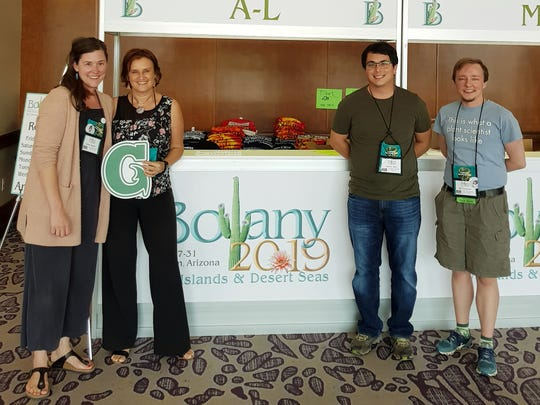 """University of Guam Center for Island Sustainability Associate Director Else Demeulenaere gained international recognition for her research and local advocacy on the critically endangered håyun lågu, or Serianthes nelsonii, during the 2019 Botany Conference in Tucson, Arizona. Her proposal, """"Bringing Biocultural Diversity to the Forefront of the Political Agenda in Guam,"""" will give her the opportunity to further advocate for endemic plants, cultural practices, and the protection of sacred places like Litekyan at a policy level. From left: Krissa Skogen, co-chair, Botanical Society of America Public Policy Committee; Demeulenaere; Andrew Pais, chair, American Society of Plant Taxonomists Public Policy Committee; and Kal Tuominen, co-chair, BSA Public Policy Committee"""