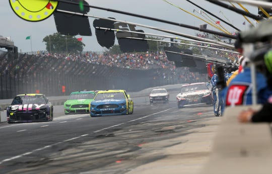 Drivers hit their pits during the 2019 Big Machine Vodka 400 at the Brickyard at Indianapolis Motor Speedway on Sunday, Sept. 8, 2019.