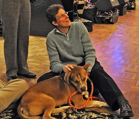 Krissi Davis pets Ambrose, a hound terrier mix, at the Wine, Wags & Whiskers fundraiser for Humane Society for Hamilton County in 2010.