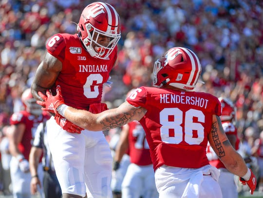 Hoosiers running back Stevie Scott III (8) celebrates with Indiana Hoosiers tight end Peyton Hendershot (86) after a touchdown during the game against Eastern Illinois at Memorial Stadium in Bloomington, Ind., on Saturday.