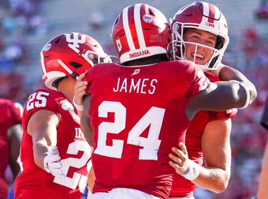 Indiana Hoosiers running back Sampson James (24) and Indiana Hoosiers quarterback Peyton Ramsey (12) celebrate after a touchdown during the game against Eastern Illinois at Memorial Stadium in Bloomington, Ind., on Saturday, Sept. 7, 2019.