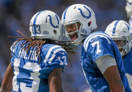 Indianapolis Colts quarterback Jacoby Brissett (7) celebrates his touchdown pass to wide receiver T.Y. Hilton (13) in the second quarter of their game at Dignity Health Sports Park in Carson, CA., on Sunday, Sept., 8, 2019.