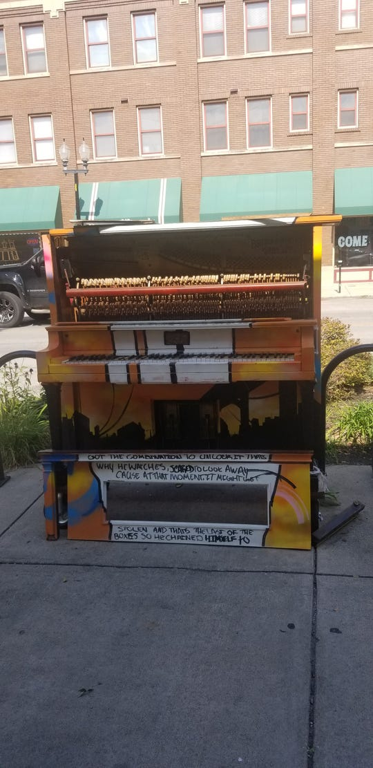 The front panel of the Artful Piano was removed — just part of the damage The District Theatre noted on the piece of public art.