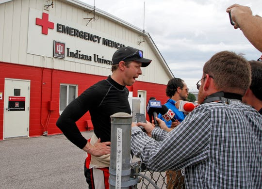 Monster Energy NASCAR Cup Series driver Brad Keselowski (2) talks to the media at the infield Indiana University Emergency Medical Center on lap 49, after Erik Jones and Keselowski wrecked hard off Turn 2, which sent Keselowski shooting down into and on top of a tire barrier on the inside wall.