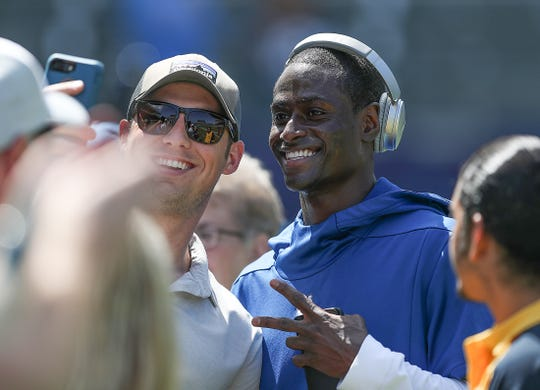 Indianapolis Colts cornerback Pierre Desir (35) takes a photo with a fan before the start of their game against the Los Angeles Chargers at Dignity Health Sports Park in Carson, CA., on Sunday, Sept., 8, 2019.