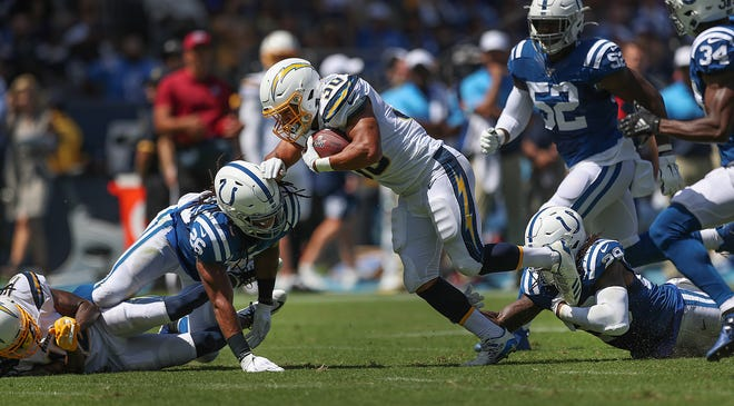 Indianapolis Colts free safety Malik Hooker (29) and Clayton Geathers (26) team up to tackle Los Angeles Chargers running back Austin Ekeler (30) in the first half of their game at Dignity Health Sports Park in Carson, CA., on Sunday, Sept., 8, 2019.