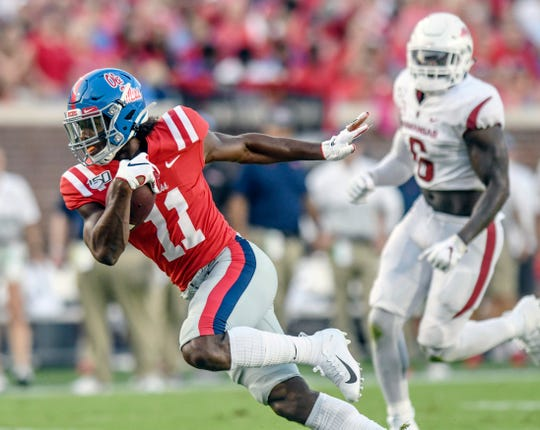 Ole Miss wide receiver Dontario Drummond (11) catches a pass against Arkansas during the first half of an NCAA college football game, Saturday, Sept. 7, 2019, in Oxford, Miss.