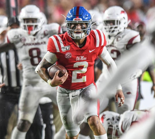 Mississippi quarterback Matt Corral (2) runs during the first half of an NCAA college football game against Arkansas, Saturday, Sept. 7, 2019, in Oxford, Miss.