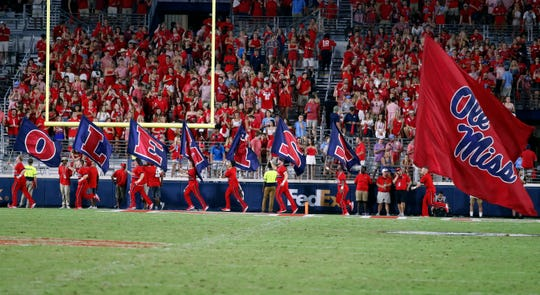 Ole Miss cheerleaders celebrate a score Arkansas during an NCAA college football game Saturday, Sept. 7, 2019, in Oxford, Miss.