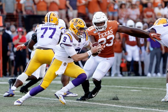LSU quarterback Joe Burrow (9) scrambles up field during the first half of an NCAA college football game against the Texas, Saturday, Sept. 7, 2019, in Austin, Texas. (AP Photo/Eric Gay)