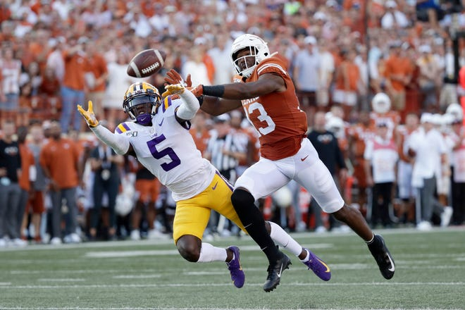 LSU cornerback Kary Vincent Jr. (5) breaks up a pass intended for Texas wide receiver Brennan Eagles (13) during the first half of an NCAA college football game Saturday, Sept. 7, 2019, in Austin, Texas. (AP Photo/Eric Gay)