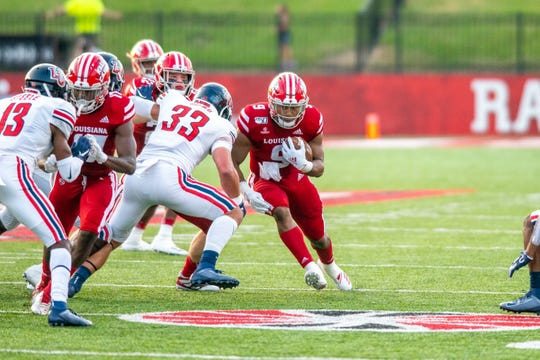 UL's Trey Ragas drives the ball down the field as the Ragin' Cajuns take on the Liberty University Flames at Cajun Field on Saturday, Sept. 7, 2019.
