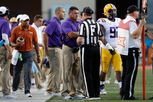 LSU head coach Ed Orgeron, center, questions a call during the first half of an NCAA college football game against Texas, Saturday, Sept. 7, 2019, in Austin, Texas. (AP Photo/Eric Gay)