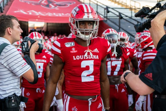 UL's Ja'Marcus Bradley leads the team out of the tunnel and onto the field as the Ragin' Cajuns take on the Liberty University Flames at Cajun Field on Saturday, Sept. 7, 2019.