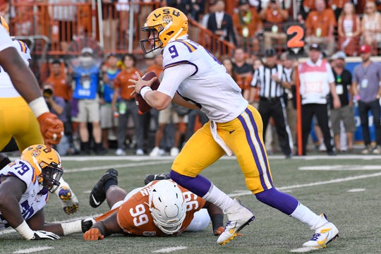 Sep 7, 2019; Austin, TX, USA; Louisiana State Tigers quarterback Joe Burrow (9) keeps the ball for a run in the first half against the Texas Longhorns at Darrell K Royal-Texas Memorial Stadium. Mandatory Credit: Scott Wachter-USA TODAY Sports