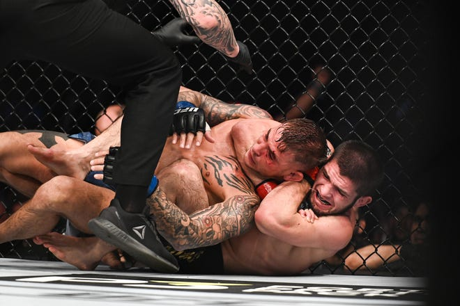 Khabib Nurmagomedov get the submission victory over Lafayette native Dustin Poirier on Saturday during UFC 242 in Abu Dhabi.