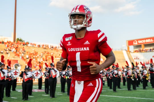 UL's quarterback Levi Lewis runs onto the field before the game as the Ragin' Cajuns take on the Liberty University Flames at Cajun Field on Saturday, Sept. 7, 2019.