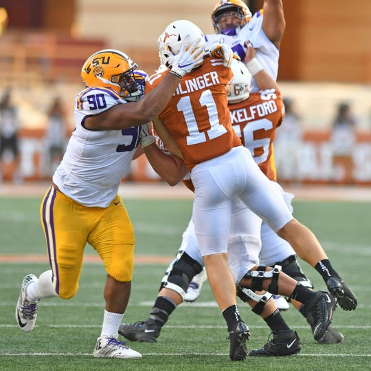 LSU defensive lineman Rashard Lawrence (90) hits Texas quarterback Sam Ehlinger (11) during an NCAA college football game Saturday, Sept. 7, 2019, in Austin, Texas. (Hilary Scheinuk/The Advocate via AP)