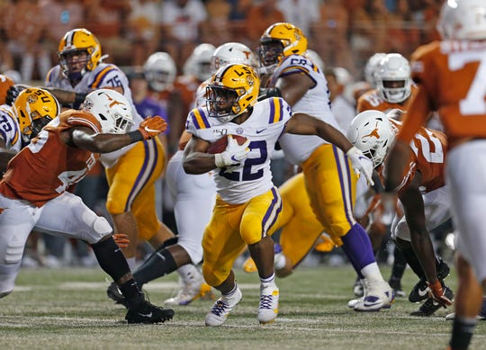 Sep 7, 2019; Austin, TX, USA; LSU Tigers running back Clyde Edwards-Helaire (22) looks for running room against the Texas Longhorns in the first half at Darrell K Royal-Texas Memorial Stadium. Mandatory Credit: Ronald Cortes-USA TODAY Sports