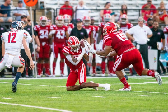 UL's Michael Jacquet III intercepts the ball during the play as the Ragin' Cajuns take on the Liberty University Flames at Cajun Field on Saturday, Sept. 7, 2019.