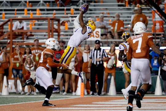 LSU wide receiver Justin Jefferson (2) pulls in a catch for a touchdown over Texas defensive back Josh Thompson (29) during the first half of an NCAA college football game Saturday, Sept. 7, 2019, in Austin, Texas. (AP Photo/Eric Gay)