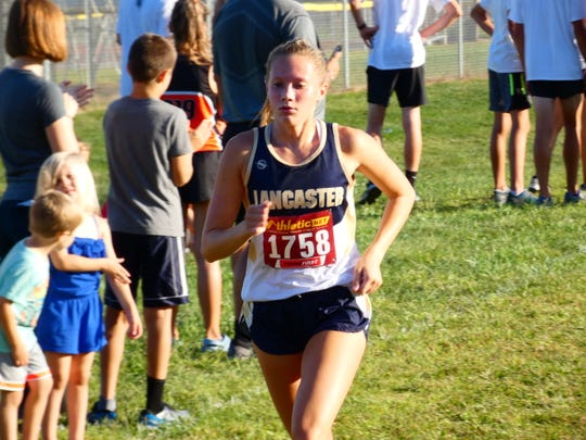 Lancaster's Sarah Craft nears the finish line during Saturday's Division I race in the McGowan Invitational at Watkins Memorial. Craft helped the Golden Gales win the team title.