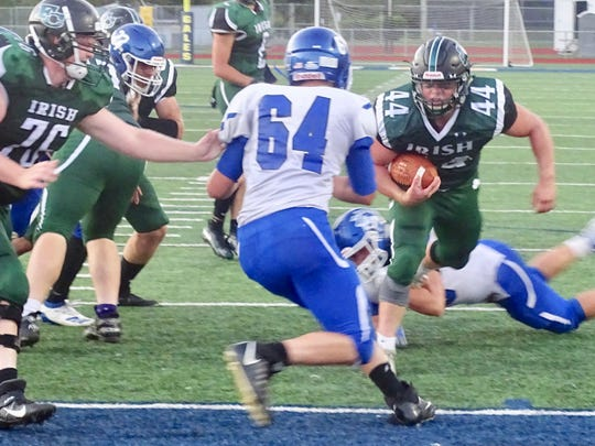 Fisher Catholic running back Trey Fabricini scores on a 4-yard touchdown run against Crestline in the Irish's 55-14 win Saturday night at Fulton Field.