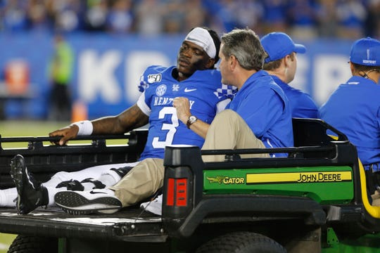Sep 7, 2019; Lexington, KY, USA; Kentucky Wildcats quarterback Terry Wilson (3) is carted off the field after being injured in the game against the Eastern Michigan Eagles at Kroger Field.