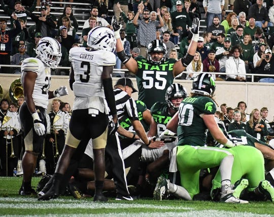 MSU OT Jordan Reid (55) proclaims a Spartan touchdown against WMU Saturday, Sept. 7, 2019, at Spartan Stadium.