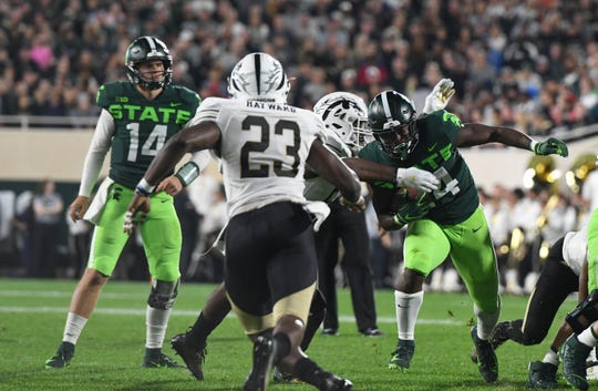 MSU's Elijah Collins gains yardage against Western Michigan, Saturday, Sept. 7, 2019, at Spartan Stadium.