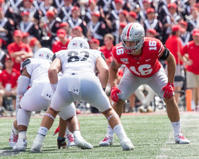 Lexington grad and true freshman Cade Stover saw his first action at linebacker for Ohio State on Saturday, making two tackles in the 42-0 win over Cincinnati.