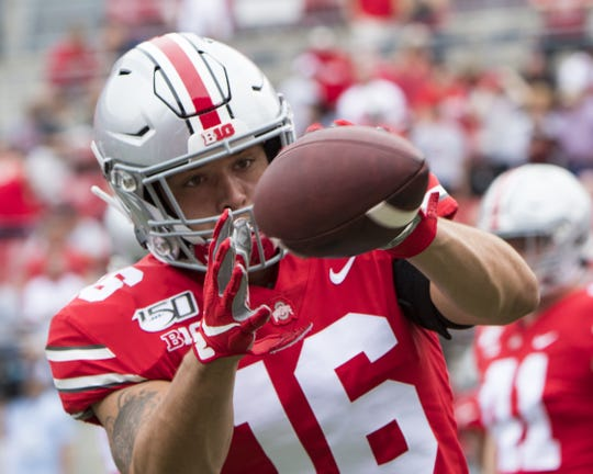 Lexington grad Cade Stover catches a pass while warming up as a linebacker for Ohio State's 2019 home opener. Now he'll be catching passes for real, having moved from defense to tight end.