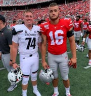 Former Lexington teammates reuunited before Saturday's game in Ohio Stadium. Cade Stover is a linebacker for Ohio State and Blake Bammann is a long-snapper for Cincinnati.