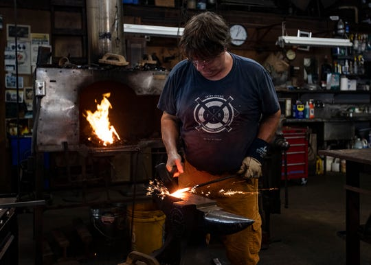Jim Masterson creates a scroll coat hook during a blacksmithing presentation at the Memphis Metal Museum on Sunday, Sept. 8, 2019.