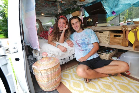Robert Claud Diedrich and his girlfriend, Melissa Anewenter, are pictured in their 2011 Ford E-350 van outside Diedrich's parents' home in Fox Point. Diedrich, a 2019 graduate of Nicolet High School in Glendale, and Anewenter, a 2019 graduate of Port Washington High School, are both temporarily forgoing college to tour the country in their converted van.