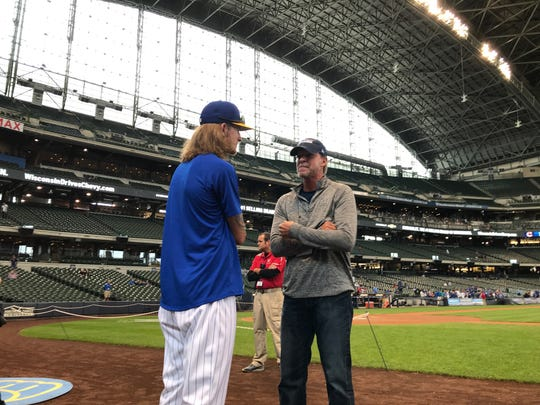 PGA golfer and Ryder Cup captain Steve Stricker chats with Brewers reliever Josh Hader before Sunday's game at Miller Park.
