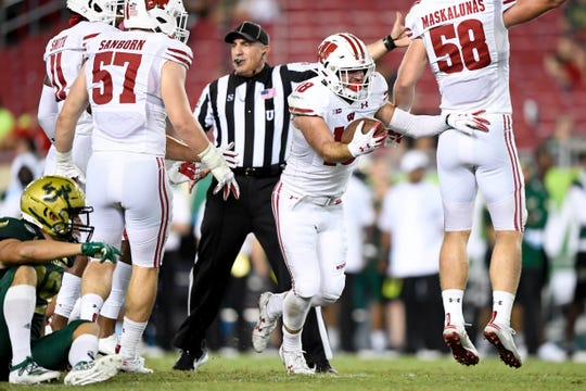 Badgers safety Collin Wilder (18) reacts to an interception against South Florida on Aug. 30.