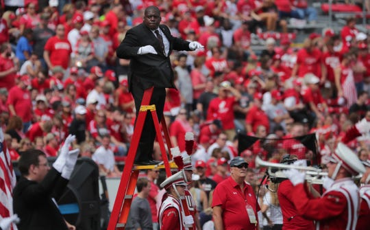 UW-Madison marching band director Corey Pompey directs for the first time before a football game Sept. 7 at Camp Randall. Pompey replaced Mike Leckrone, who retired last spring after leading the band for a half-century.