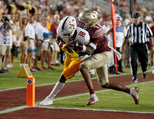 ULM wide receiver Jonathan Hodoh (18) is driven out of bounds at the one yard line by Florida State defensive back Stanford Samuels III (8) during the second half at Doak Campbell Stadium.