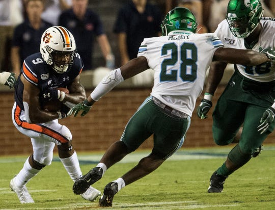 Auburn running back Kam Martin (9) runs the ball at Jordan-Hare Stadium in Auburn, Ala., on Saturday, Sept. 7, 2019. Auburn defeated Tulane 24-6.