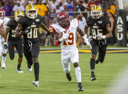 Tuskegee's Devarens Valcin (19) is wide eyed as he returns a kickoff 99 yards for a touchdown Saturday against Alabama State.