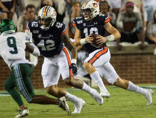 Auburn quarterback Bo Nix (10) runs the ball at Jordan-Hare Stadium in Auburn, Ala., on Saturday, Sept. 7, 2019. Auburn leads Tulane 14-6 at halftime.