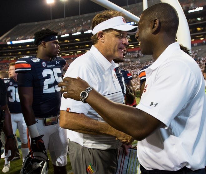 Auburn head coach Gus Malzahn shakes hands with athletic director Allen Greene after a 24-6 win over Tulane at Jordan-Hare Stadium in Auburn, Ala., on Saturday, Sept. 7, 2019.