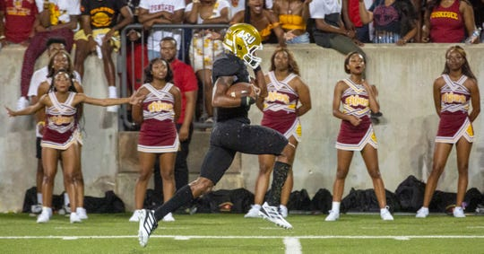 ASU's Duran Bell (3) saunters into the end zone during the third quarter as Tuskegee's cheerleaders react in the background.