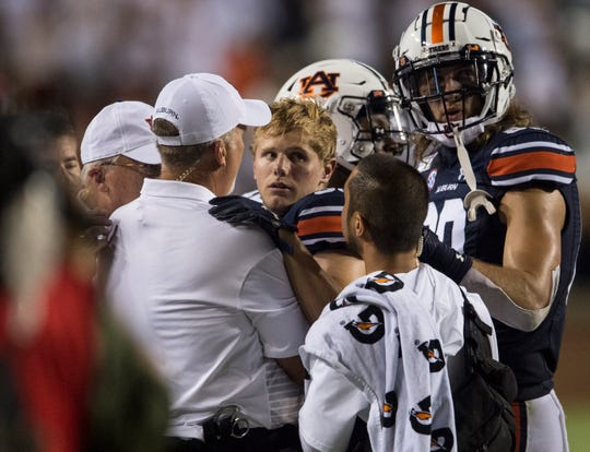 Auburn wide receiver Will Hastings (33) is helped off the field by medical staff after taking a big hit at Jordan-Hare Stadium in Auburn, Ala., on Saturday, Sept. 7, 2019. Auburn defeated Tulane 24-6.
