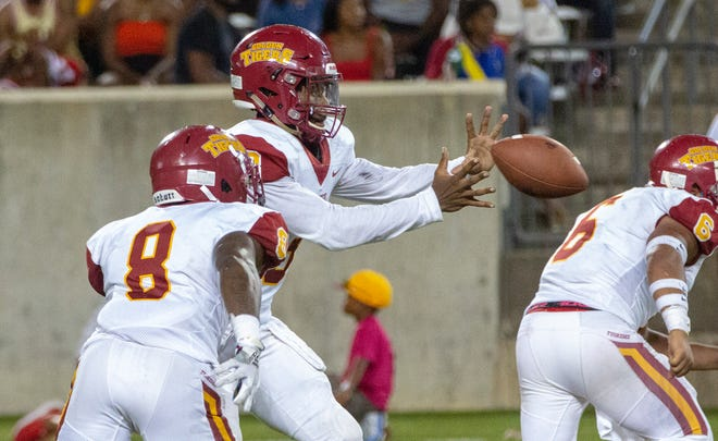 Tuskegee's Ahmad Deramus (3) reaches out to catch a snap during the second half.