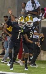 ASU's Jeremiah Hixon (1) celebrates a touchdown by his teammate Duran Bell (3).